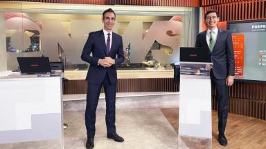 César Tralli e Nilson Klava sorrindo no estúdio da GloboNews