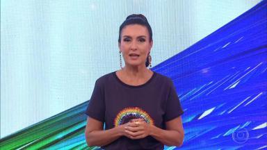 Fátima Bernardes no palco do Encontro com roupa homenageando o Dia Internacional do Orgulho LGBTQIA+