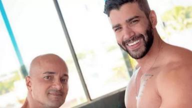 Gusttavo Lima ao lado do seu personal