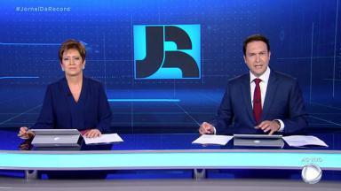 Christina Lemos e Eduardo Ribeiro na bancada do Jornal da Record