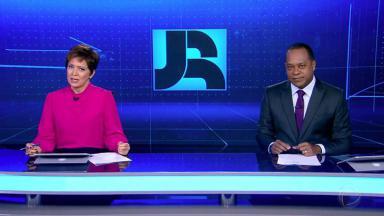 Christina Lemos e Luiz Fara Monteiro na bancada do Jornal da Record
