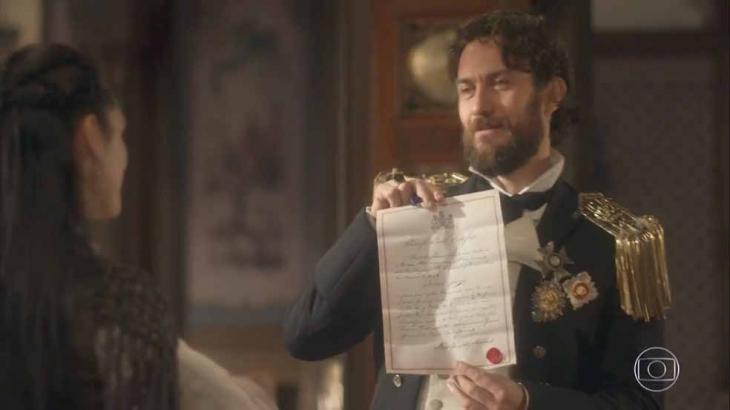 Thomas mostra certidão de nascimento à Anna em Novo Mundo - Divulgação/TV Globo