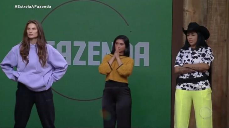 Dayane Mello, Mileide Mihaile e Fernanda Medrado demonstram tensão diante de um bate-boca no reality A Fazenda