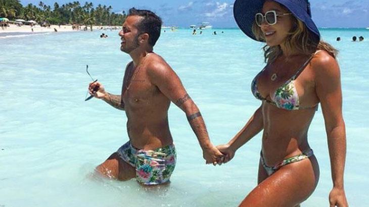 Thammy Miranda combina sunga com maiô da namorada em praia