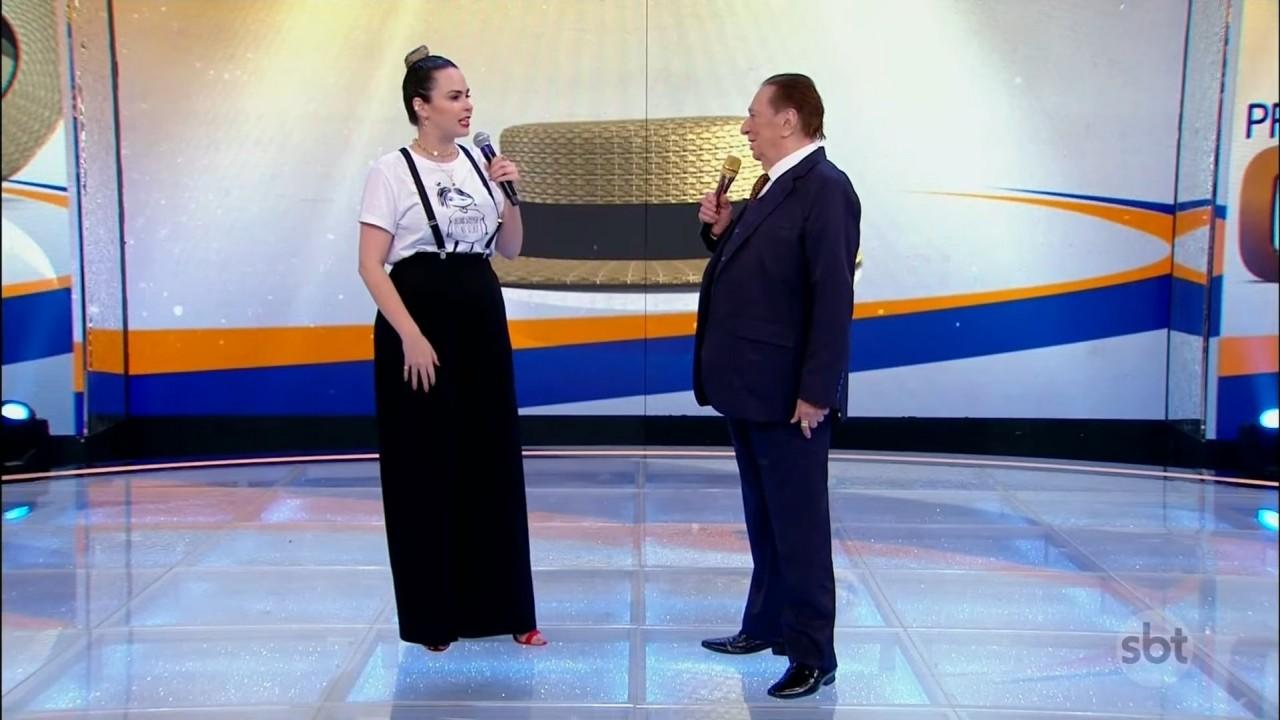 Ana Paula Renault ao lado de Raul Gil no palco