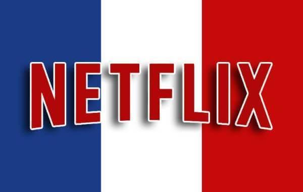 Logo da Netflix com a bandeira francesa ao fundo