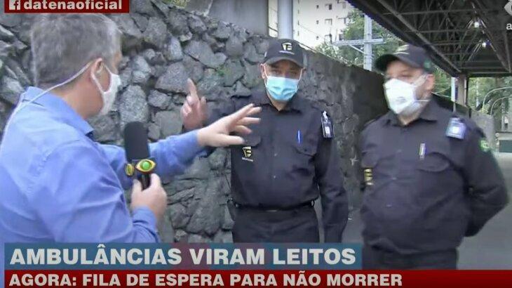 Repórter sendo impedido de entrar em hospital por seguranças