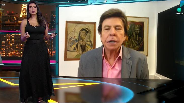 Flávia Noronha (no estúdio) e Nelson Rubens (no telão) apresentam o TV Fama