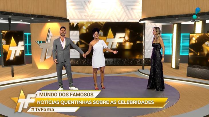 Trio de apresentadores no TV Fama dando as mãos